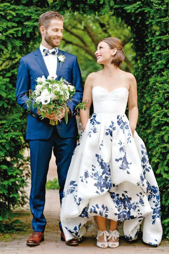 Choose a Non-white wedding dress, such as this modern floral design.