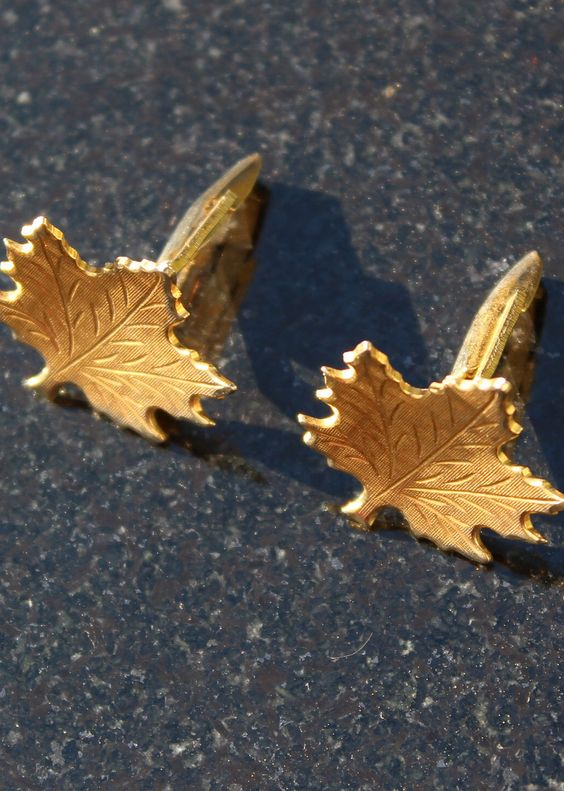 Use maple leaf cuff links or earring at your fall wedding. These cuff links can be found on Etsy.