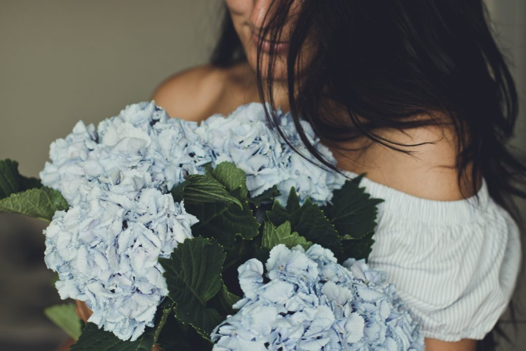 Women with Something Blue Flowers