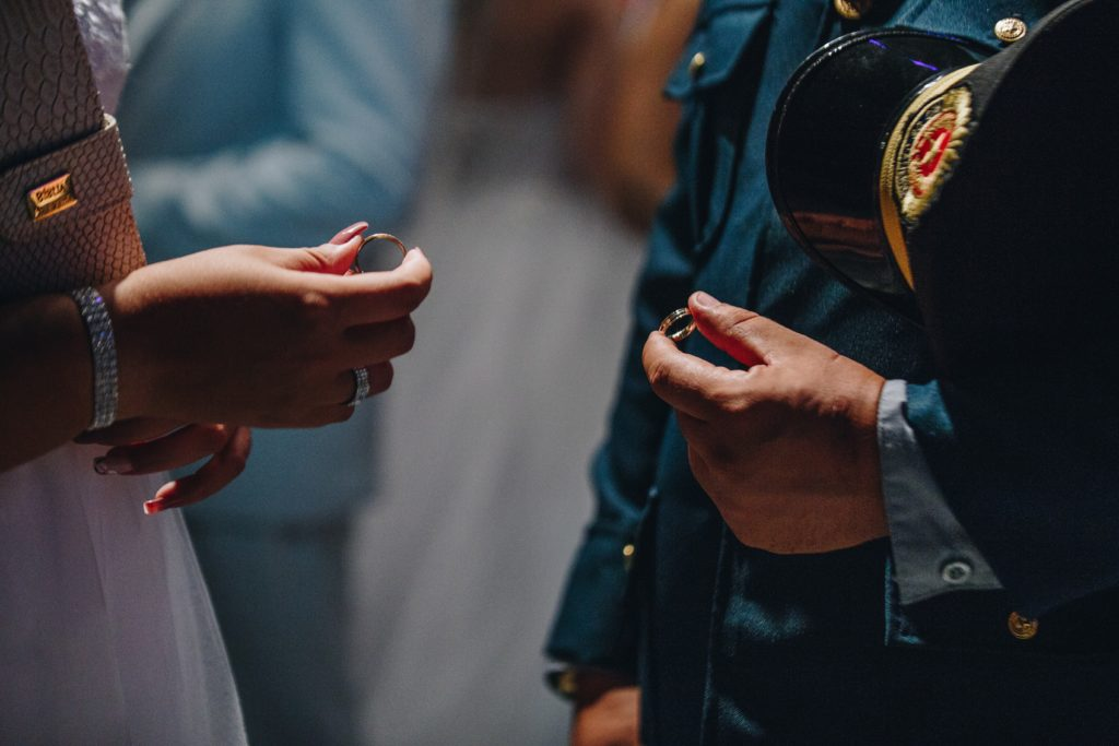 Military Couple Exchanging Rings