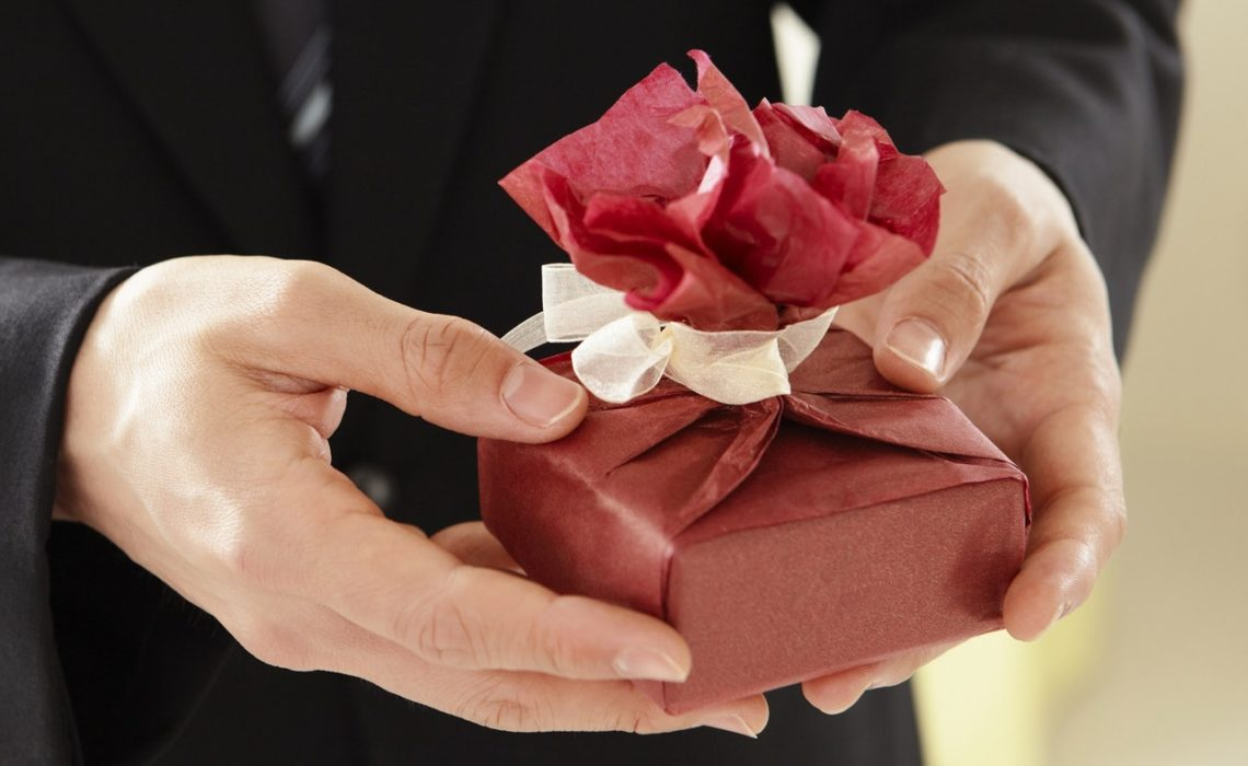 man giving gift