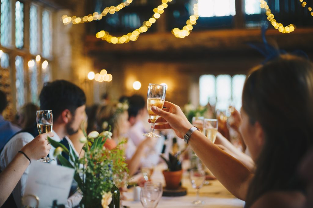 guests toasting at wedding reception